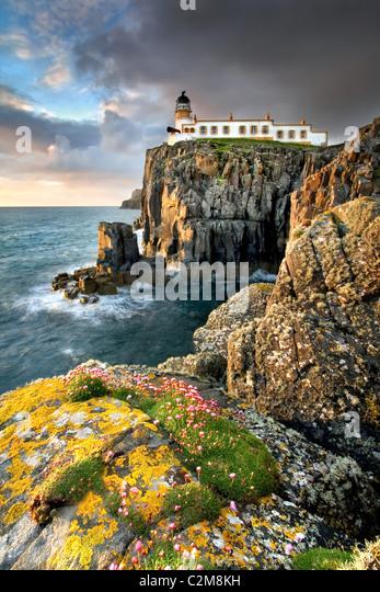 Neist point lighthouse at sunset - Stock Image
