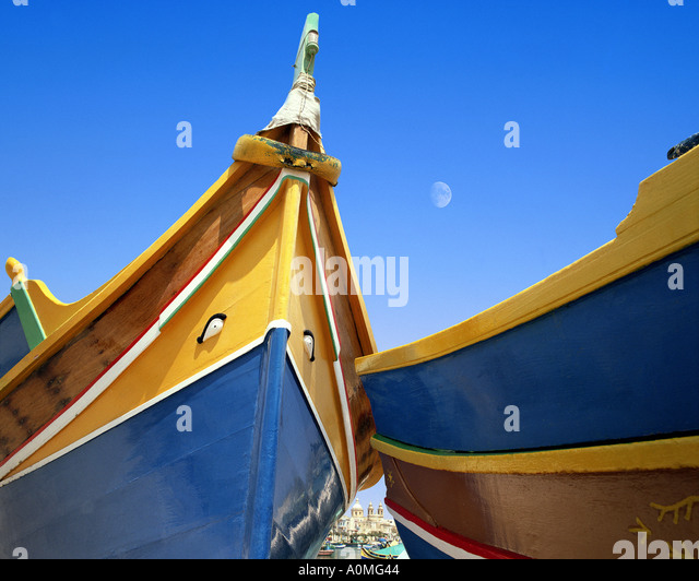 MT - MALTA: Typical Maltese Boats at Marsaxlokk Harbour - Stock Image