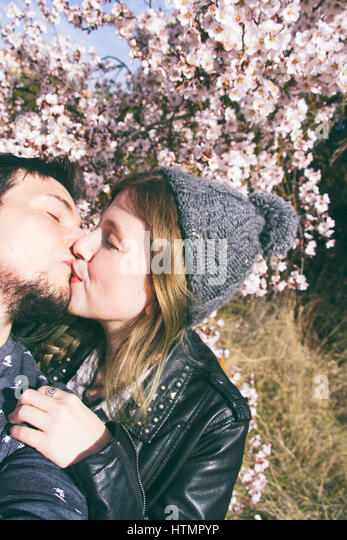 Young hipster couple in love in spring - Stock Image
