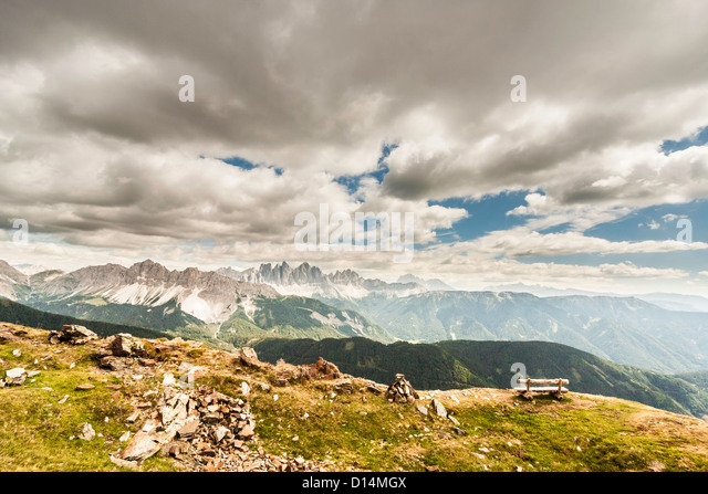 Clouds over grassy rural landscape - Stock Image