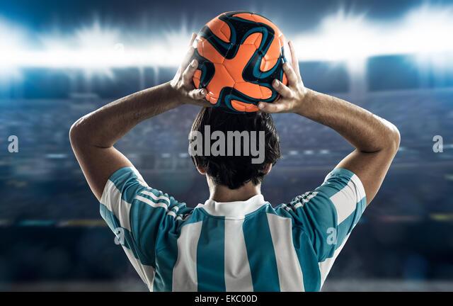 Footballer throwing in - Stock Image