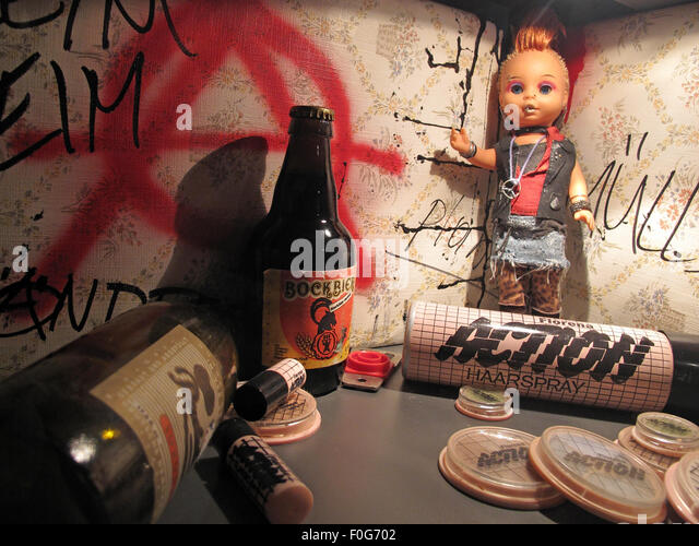 Berlin beer graffiti doll Action DDR hairspray and makeup,Germany - Stock Image