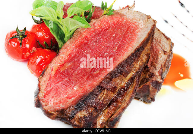 Medium Grilled steaks and savory tomato sauce - Stock Image
