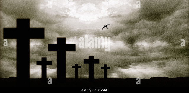 Graveyard with a bird hovering above - Stock Image