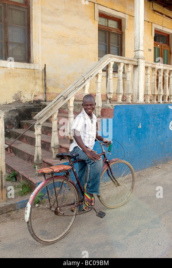 A boy standing over his bicycle, Quelimane, Mozambique - Stock Image
