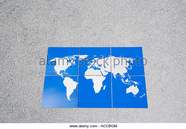 Earth puzzle on gravel outdoors - Stock Image