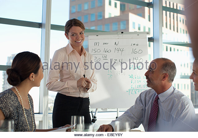 Business people sitting in meeting - Stock-Bilder