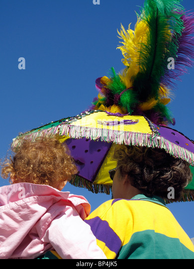 Watching Mardi Gras Parade - Stock Image