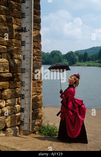 Ohio Meigs County Pomeroy Ohio River town Victorian Walking Tour guide inspects high water gauge - Stock Image
