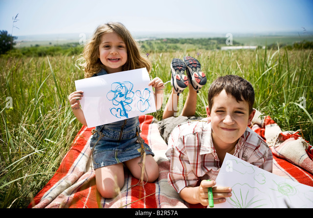 Two children showing their drawings - Stock-Bilder