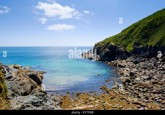 Small cove at Cadgwith, Lizard Peninsula, Cornwall, England, UK - Stock Image