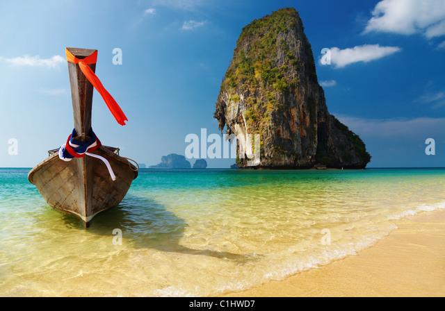 Tropical beach, long tail boat, Andaman Sea, Thailand - Stock Image