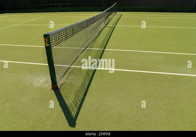 tennis net with shadow. - Stock Image