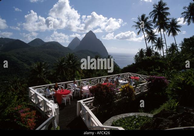 West Indies St. Lucia Soufriere La Haut Plantation Restaurant dining deck Les Pitons mountains Caribbean Sea - Stock Image
