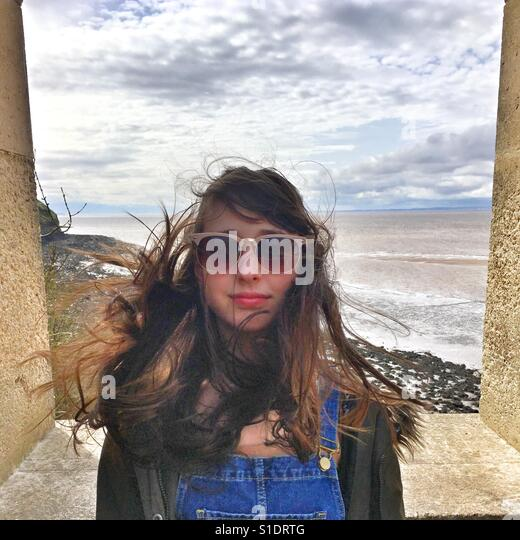 Portrait of a girl with long hair on a windy day - Stock-Bilder