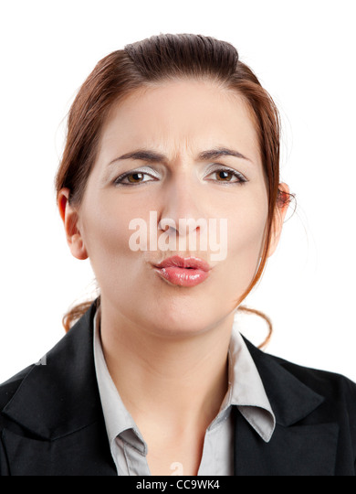 Portrait of a beautiful business making pout, isolated on white - Stock Image