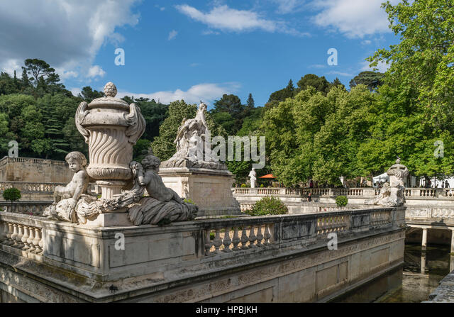 Le Nymphée with sculpture group at the park Les Jardin de la Fontaine in Nimes, France - Stock Image