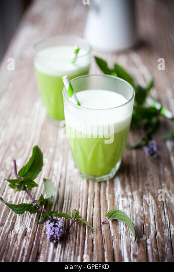 Healthy green juice from fruit and vegetable - Stock Image