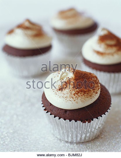 Frosted Chocolate Cupcakes in Foil Liners - Stock Image