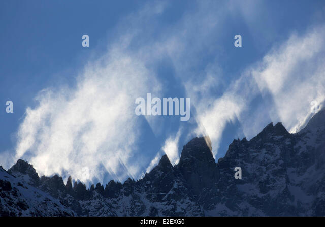 France, Haute Savoie, Chamonix, clouds movements on the Grands Montets ridge, Chamonix valley - Stock Image
