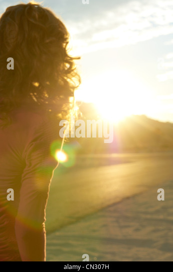 Young woman and sunlight, California, USA - Stock Image