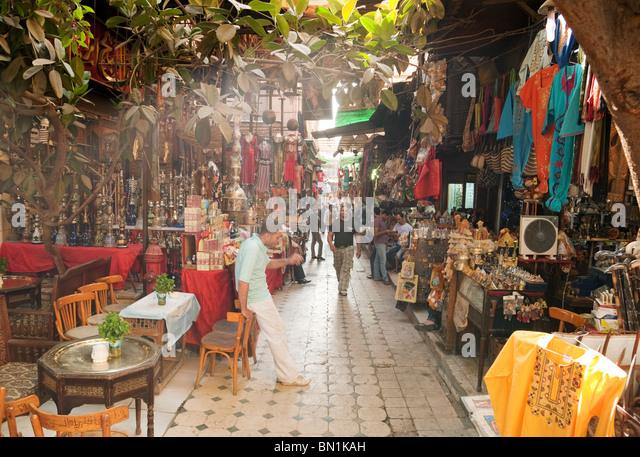 A shaft of sunlight in a street scene in Cairo's Khan al Khalili market, the Islamic quarter, cairo Egypt - Stock Image