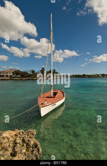 Singe red and white wooden sailboat Bayahibe fishing village Dominican Republic southeast coast boat tours to Isla - Stock Image