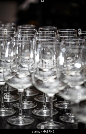 Many empty glasses for a wine on the bar table - Stock Image