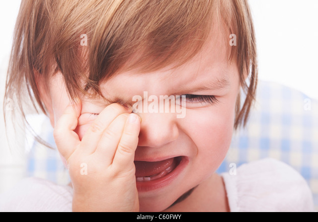 Close up of baby girl crying - Stock Image