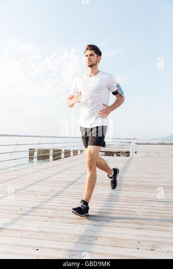 Morning jog man stock photos morning jog man stock for Terrace jogging track