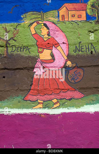 Traditional painting graffiti  on the walls of Mumbai - Stock Image