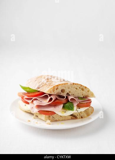 Ham, tomato and cheese sandwich - Stock Image