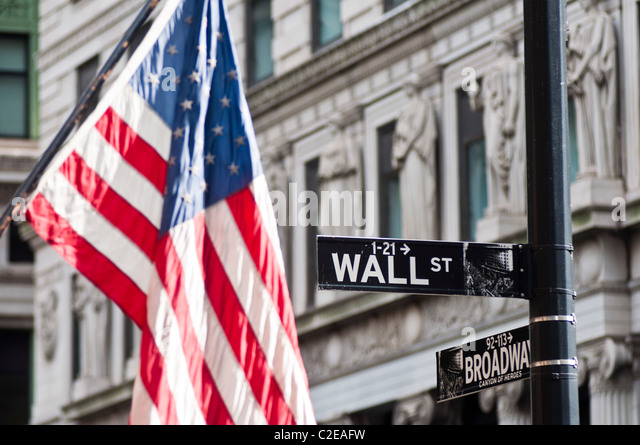 American flag and Wall Street road sing, Financial District, Lower Manhattan, New York City, USA - Stock Image