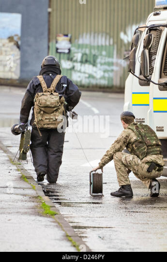 Belfast, Northern Ireland, UK. 14th January 2013.   Army ATO from 321 Squadron, 11 EOD Regiment, dressed in a bomb - Stock Image