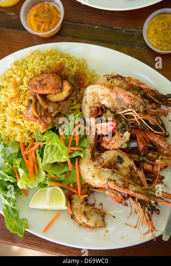 Plate of seafood, rice and salad - Stock Image