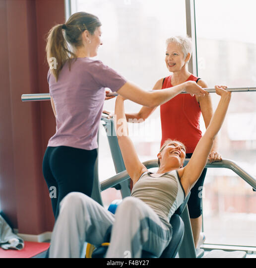 20-24 years 70-74 years 75-79 years activity adults only athlete bodybuilding color image elderly woman exercising - Stock Image