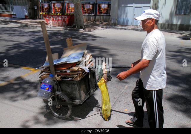Argentina Mendoza Villa Nueva street scene cart cardboard boxes flattened recycling waste picker picking Hispanic - Stock Image