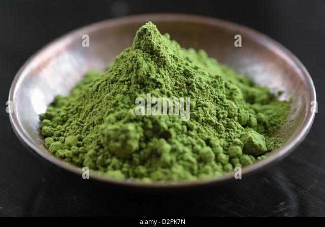 Powdered Green Tea, Matcha Tea in a bowl - Stock Image