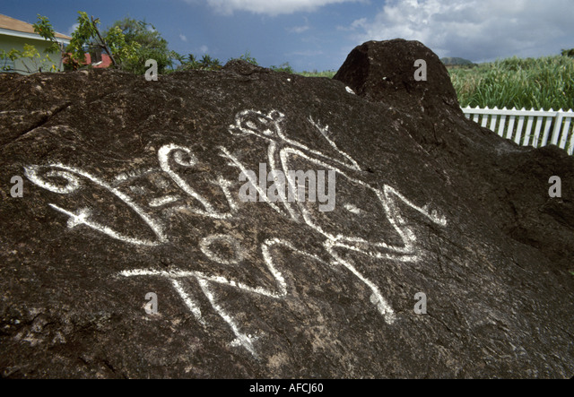 West Indies St. Kitts Old Road Carib Indian petroglyph rock drawing - Stock Image