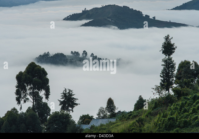 Early morning mist rising above lake in Uganda - Stock Image