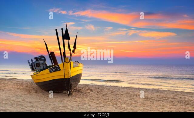 Fishing boat at Baltic Sea, sunset time, Pomerania, Poland - Stock Image