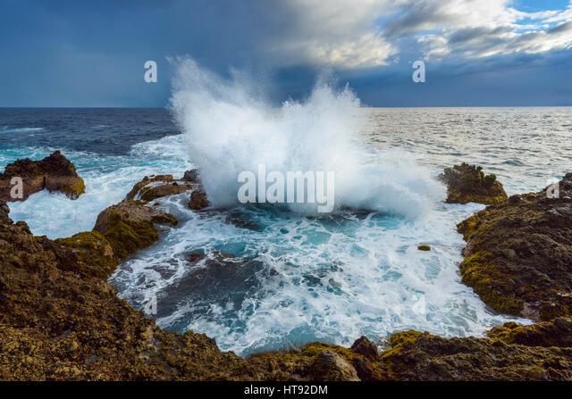 Lava Rock Coast at Sunrise with Breaking Waves, Charco del Viento, La Guancha, Tenerife, Canary Islands, Spain - Stock-Bilder