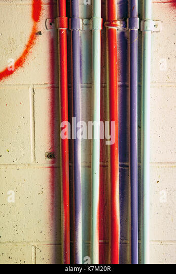 Colorful pipes at Abandoned Power Station near Jordan River, Vancouver Island, British Columbia, Canada - Stock Image