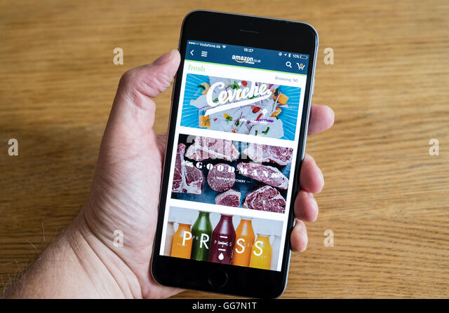 Amazon Prime Fresh food delivery service app shown on an iPhone 6 smart phone - Stock Image