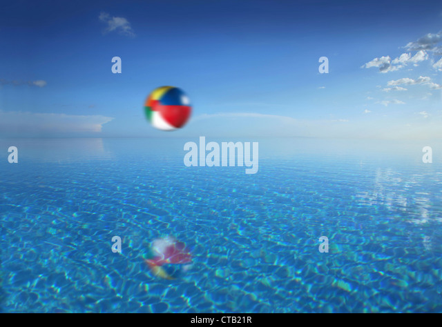 Beachball flying over an infinity pool, Bohol island, Visayas, Philippines - Stock Image