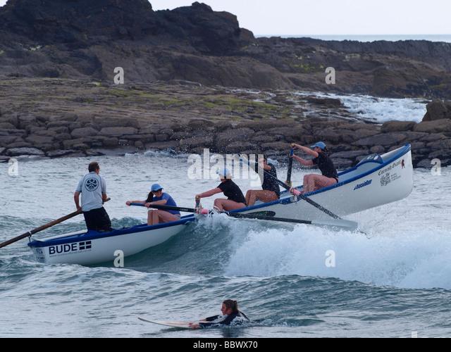 Gig boat team battling through waves - Stock Image