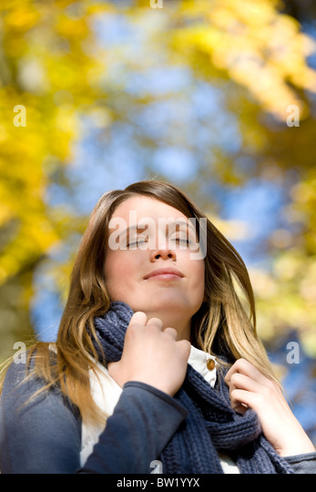 Autumn park - fashion model woman on sunny day - Stock Image