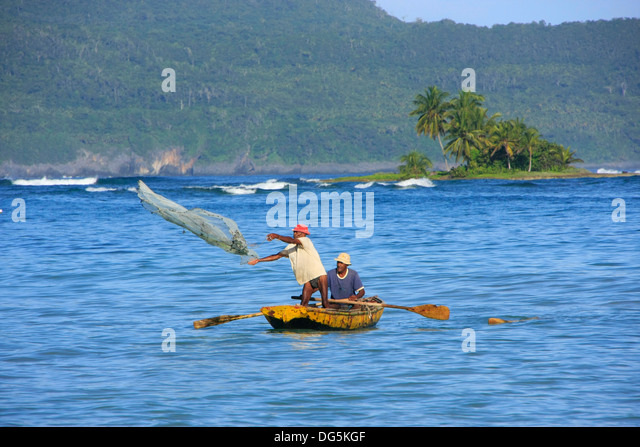 Local men fishing near Las Galeras, Samana peninsula, Dominican Republic - Stock Image