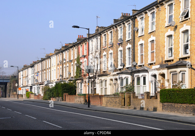 Long row of terraced flats without parked cars close to Hackney town centre - Stock Image