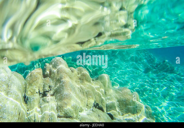 Beach tropical with turquoise water ripple reflection texture, Emerald coast, Sardinia, Italy. - Stock Image